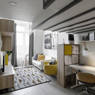 Свежая идея для дизайна: изолированная гостиная комната среднего размера в скандинавском стиле с белыми стенами, отдельно стоящим ТВ, серым полом и полом из ламината - отличное фото интерьера