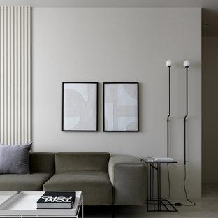 Idee per un soggiorno minimal di medie dimensioni e chiuso con angolo bar, pareti beige, pavimento in gres porcellanato, nessun camino, TV a parete e pavimento beige
