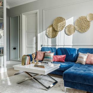 На фото: большая гостиная комната в стиле современная классика с серыми стенами, светлым паркетным полом и бежевым полом с