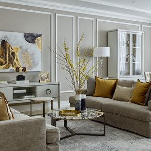 На фото: парадная гостиная комната среднего размера в стиле неоклассика (современная классика) с серыми стенами и многоуровневым потолком