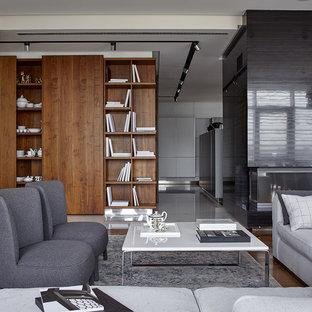 Идея дизайна: открытая гостиная комната в современном стиле с белыми стенами, паркетным полом среднего тона, стандартным камином и коричневым полом