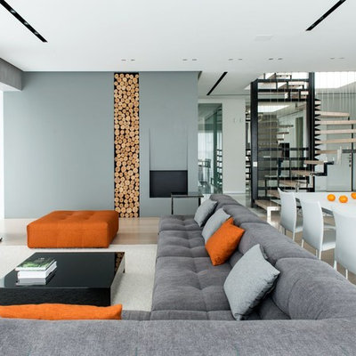 Example of a large trendy open concept and formal beige floor and light wood floor living room design in Moscow with gray walls and a wall-mounted tv