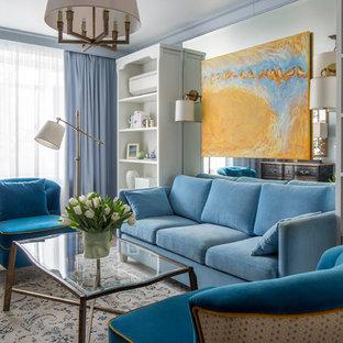 Свежая идея для дизайна: парадная, изолированная гостиная комната в классическом стиле с синими стенами, паркетным полом среднего тона и телевизором на стене без камина - отличное фото интерьера