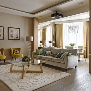 На фото: большая парадная, открытая гостиная комната в современном стиле с бежевыми стенами, паркетным полом среднего тона и бежевым полом с