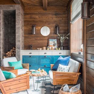 На фото: маленькая открытая гостиная комната в стиле современная классика с коричневыми стенами, полом из керамогранита, разноцветным полом, деревянным потолком и деревянными стенами без ТВ с