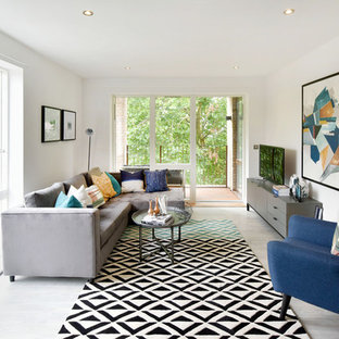 Photo of a contemporary games room in London with white walls, a freestanding tv and grey floors.
