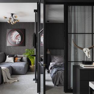 Imagen de salón industrial, pequeño, sin chimenea, con paredes negras, suelo gris y suelo de cemento