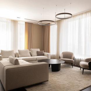 На фото: гостиная комната в стиле модернизм с бежевыми стенами, темным паркетным полом и коричневым полом