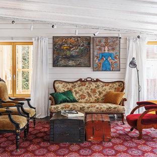 Diseño de salón abierto, bohemio, de tamaño medio, con paredes blancas y moqueta