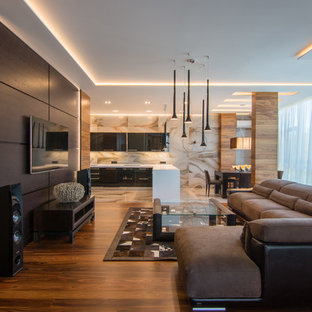 Inspiration for a large contemporary formal open plan living room in Other with medium hardwood flooring, a wall mounted tv and brown walls.