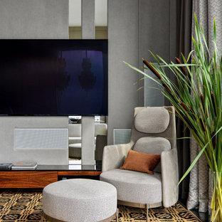 На фото: гостиная комната в современном стиле с серыми стенами, мультимедийным центром и панелями на стенах