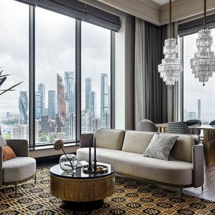 Idéer för ett modernt vardagsrum, med grå väggar och mellanmörkt trägolv