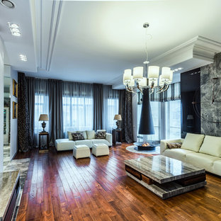 Example of a classic open concept medium tone wood floor living room design in Saint Petersburg with a wall-mounted tv, a hanging fireplace and a metal fireplace