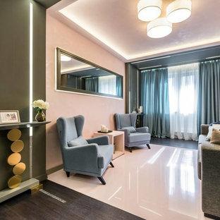 Esempio di un soggiorno design chiuso con pareti rosa, pavimento in cemento e pavimento rosa