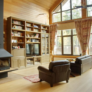 Example of a classic living room design in Moscow with a hanging fireplace and a metal fireplace