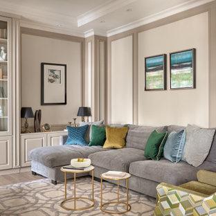 Идея дизайна: открытая гостиная комната среднего размера в стиле современная классика с бежевыми стенами, бежевым полом, отдельно стоящим ТВ, светлым паркетным полом и панелями на части стены без камина