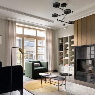Свежая идея для дизайна: парадная гостиная комната в стиле модернизм с серыми стенами, темным паркетным полом, стандартным камином, фасадом камина из камня и черным полом - отличное фото интерьера