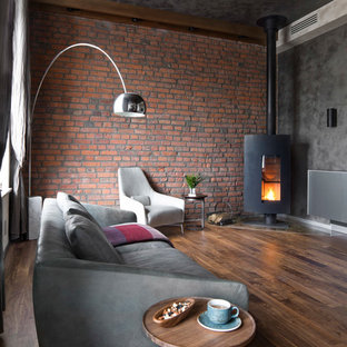living room industrial open concept dark wood floor living room idea in moscow with gray - Industrial Living Room
