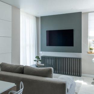 Esempio di un piccolo soggiorno design con pavimento in laminato, pavimento bianco, sala formale, pareti grigie e TV a parete