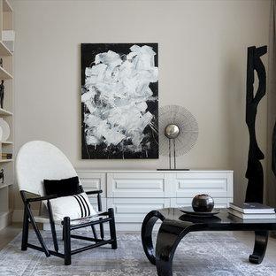 Свежая идея для дизайна: гостиная комната в современном стиле с библиотекой, полом из керамогранита, серым полом и бежевыми стенами - отличное фото интерьера