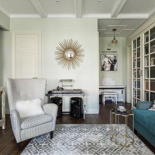 Cette photo montre un salon chic fermé et de taille moyenne avec une salle de musique, un mur vert, un sol en bois foncé, un téléviseur fixé au mur, un sol marron, un plafond à caissons et du papier peint.