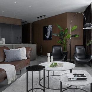 Imagen de salón para visitas abierto, contemporáneo, grande, con paredes marrones, suelo de baldosas de porcelana y suelo gris