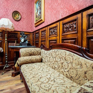 Example of a mid-sized ornate open concept family room design in Other