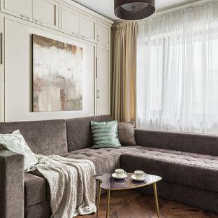 Новый формат декора квартиры: парадная гостиная комната в стиле современная классика с темным паркетным полом и коричневым полом