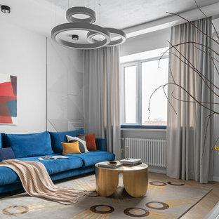 Стильный дизайн: открытая гостиная комната среднего размера в современном стиле с серыми стенами и бежевым полом - последний тренд