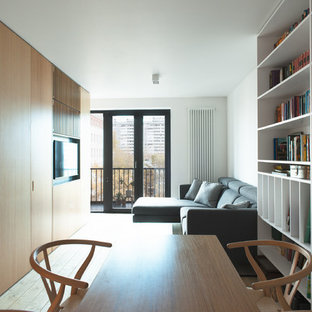 Design ideas for a scandi formal open plan living room in Moscow with white walls, painted wood flooring and a wall mounted tv.