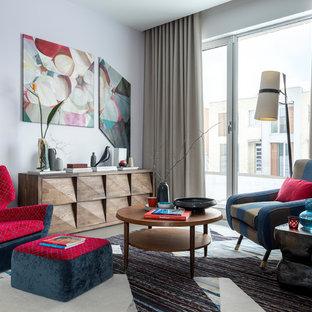 Foto di un soggiorno di medie dimensioni con pavimento in gres porcellanato, pavimento grigio e pareti bianche