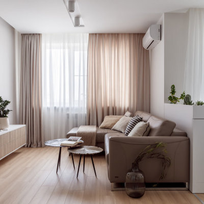 Inspiration for a mid-sized contemporary open concept beige floor and light wood floor living room remodel in Other with gray walls and a wall-mounted tv
