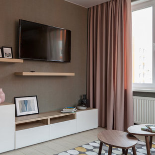 Идея дизайна: изолированная гостиная комната среднего размера в современном стиле с полом из ламината, телевизором на стене, бежевым полом и коричневыми стенами