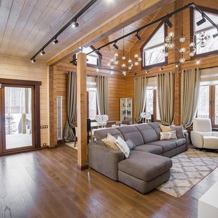 Photo of a medium sized contemporary formal open plan living room in Moscow with brown walls, medium hardwood flooring, a standard fireplace and brown floors.