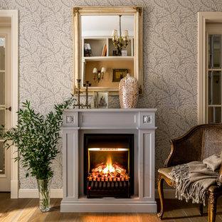 Свежая идея для дизайна: гостиная комната в классическом стиле с серыми стенами, паркетным полом среднего тона, стандартным камином и коричневым полом - отличное фото интерьера