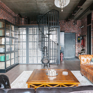 This is an example of an industrial mezzanine living room in Moscow with brown walls, medium hardwood flooring, a wood burning stove, a wall mounted tv and brown floors.