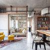 Visite Privée : Un loft avec cloisons mobiles et matériaux bruts