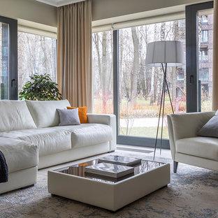 Свежая идея для дизайна: парадная, открытая гостиная комната в современном стиле с бежевыми стенами, полом из керамогранита и бежевым полом - отличное фото интерьера