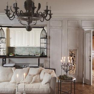 На фото: гостиная комната в классическом стиле с паркетным полом среднего тона и белыми стенами с