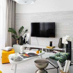 Новый формат декора квартиры: гостиная комната в современном стиле с белыми стенами, телевизором на стене и серым полом
