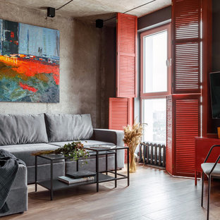 Inspiration for a medium sized contemporary living room in Other with grey walls, porcelain flooring, a wall mounted tv and beige floors.