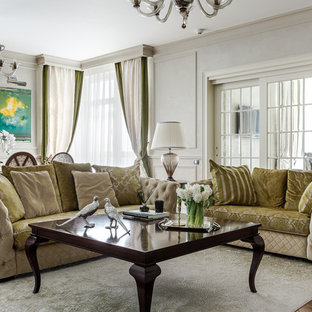 Пример оригинального дизайна: парадная гостиная комната в стиле современная классика с серыми стенами, паркетным полом среднего тона и коричневым полом
