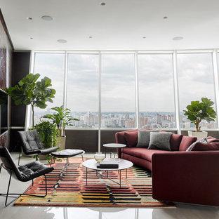 На фото: парадная гостиная комната в современном стиле с телевизором на стене и белым полом с