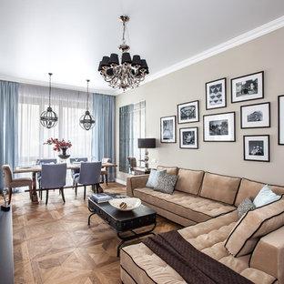 Свежая идея для дизайна: парадная гостиная комната в стиле современная классика с бежевыми стенами, паркетным полом среднего тона, двусторонним камином, отдельно стоящим ТВ и коричневым полом - отличное фото интерьера