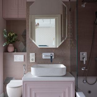 На фото: туалет в стиле современная классика с инсталляцией, розовыми стенами и настольной раковиной с