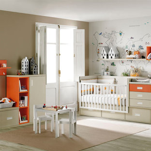 Large modern gender-neutral nursery in Other with beige walls.