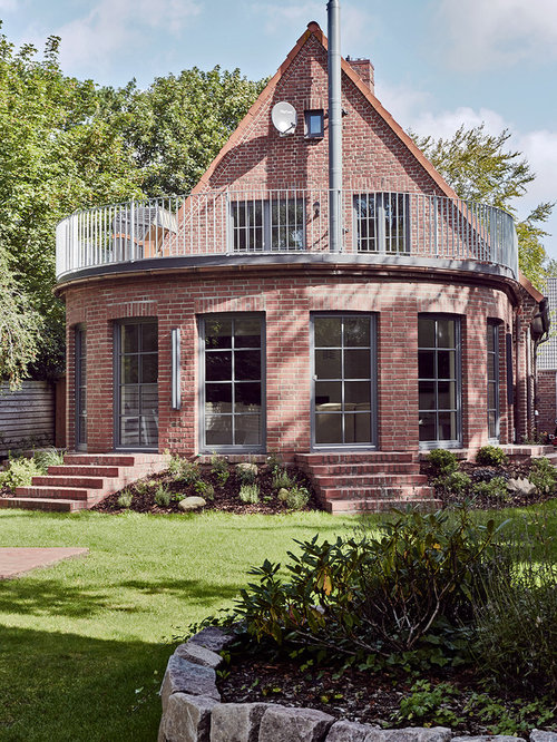 This is an example of a large victorian exterior in other with three - Scandinavian Brick Exterior Design Ideas Renovations Amp Photos