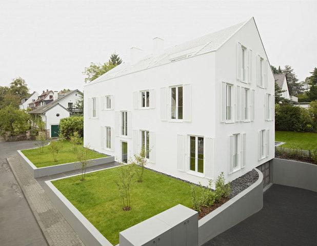 コンテンポラリー 家の外観 by Christ.Christ. associated architects GmbH
