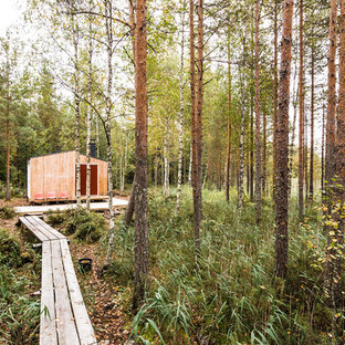 Small scandinavian one-story wood exterior home idea in Other with a shed roof and a metal roof