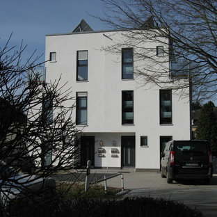 Mid-sized trendy white two-story stucco exterior home photo in Hamburg